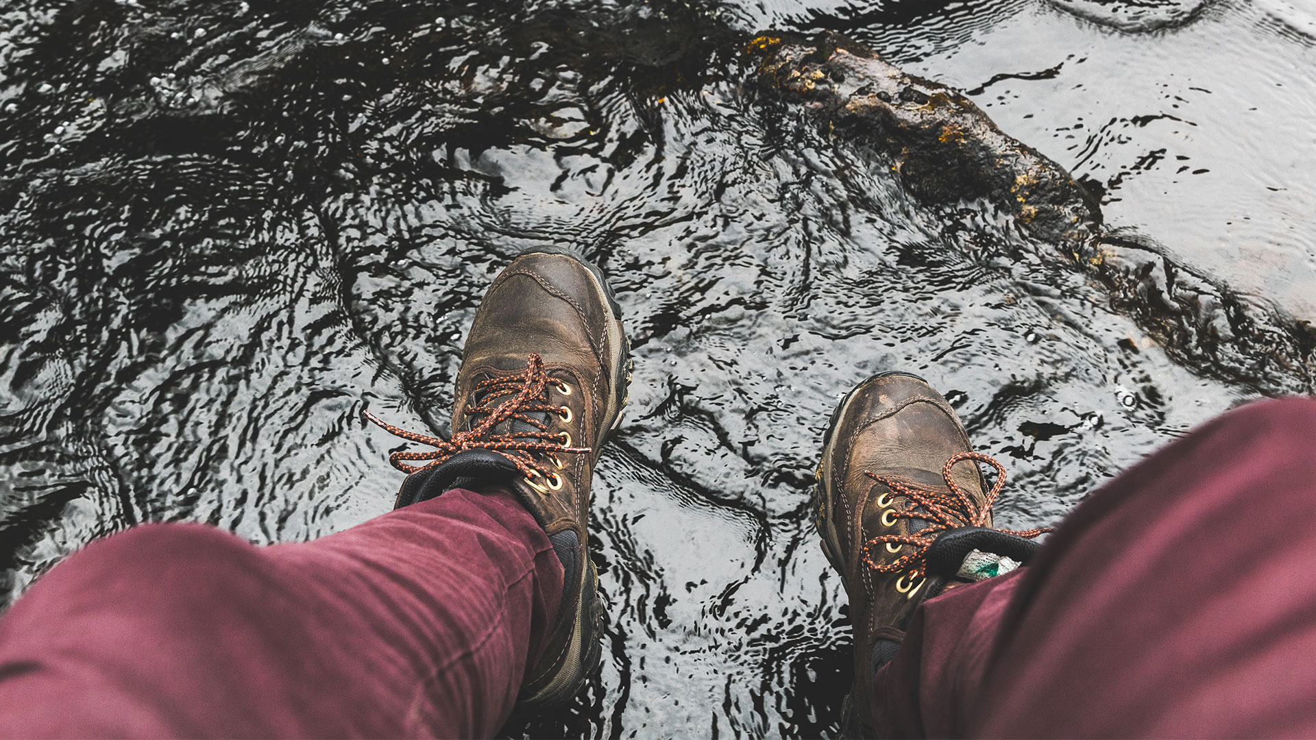 Boots standing in rippling water on the Cumberland Trail